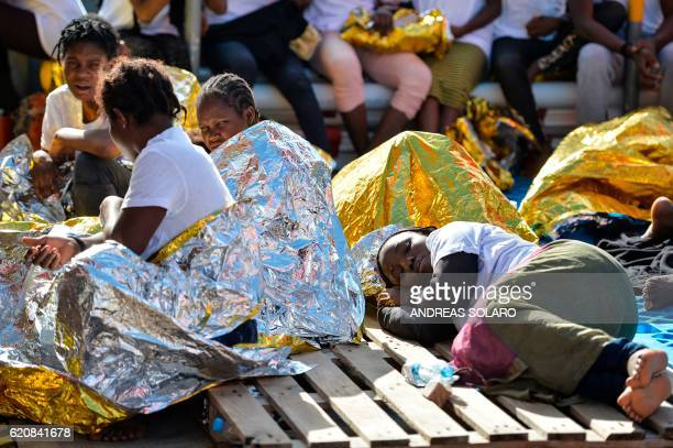 Women rest aboard the Topaz Responder ship run by Maltese NGO Moas and the Italian Red Cross after a rescue operation of migrants and refugees on...