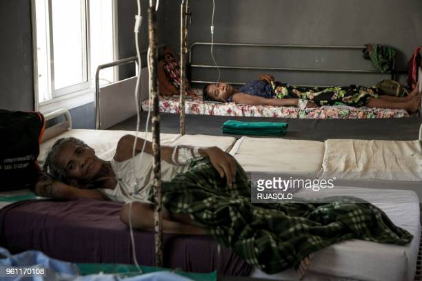 Women rest after a fistula surgery at the fistula treatment centre in Monja Joana Hospital in Ambovombe on March 20, 2018. - Obstetric fistula is one...