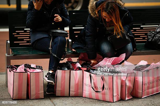 Women rest next to Victoria Secret shopping bags during Black Friday events on November 25 2016 in New York City The day after Thanksgiving called...