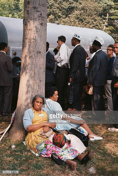 Women rest under the shade of a tree during the Freedom March to Washington More than 200000 people participated in the March on Washington...