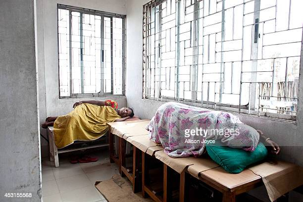 Women rest while participating in a hunger strike at a Tuba Group factory August 4 2014 in Dhaka Bangladesh Garment workers have been on a hunger...