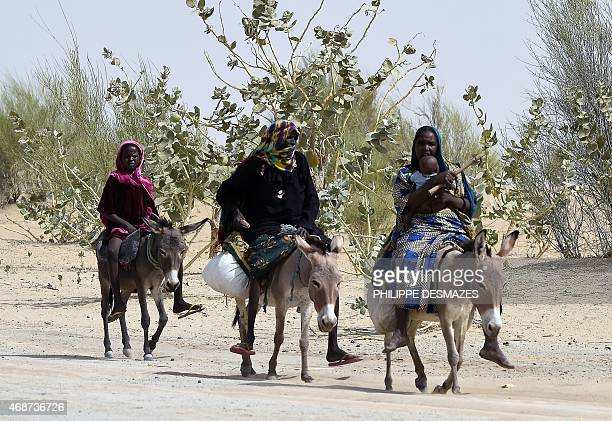 Women ride donkeys in a desert between Massakori and Baga Sola in the Chad lake region in Chad on April 5 2015 Seven civilians were killed in an...