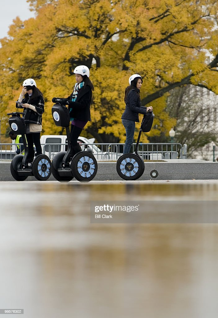 Women ride Segways on the East Plaza as part of a tour group on Thursday, Oct. 29, 2009.