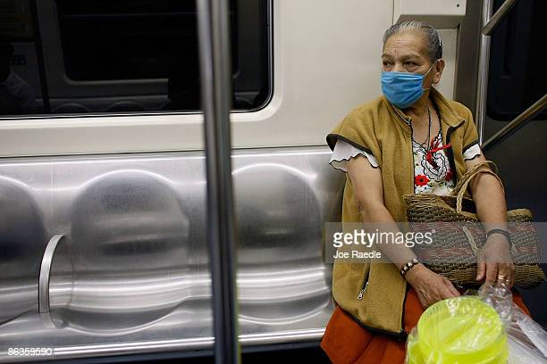 A women rides the subway as she wears a surgical masks to help prevent being infected with the swine flu on May 3 2009 in Mexico City Mexico The...