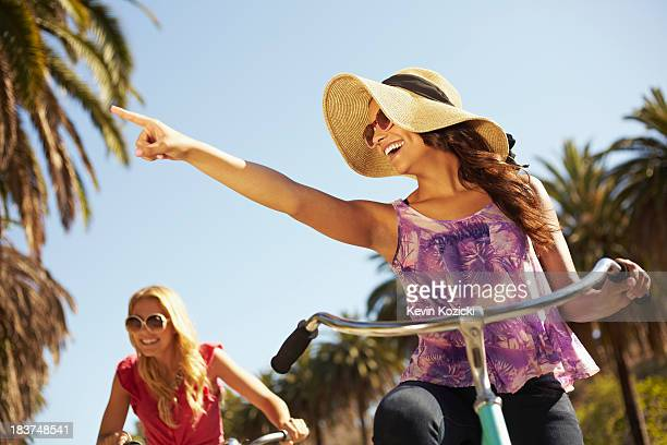women riding bicycle - drooping stock photos and pictures