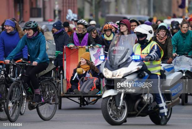 Women riding bicycles participate in the Purple Ride feminist women's bicycle protest on International Women's Day on March 08 2020 in Berlin Germany...