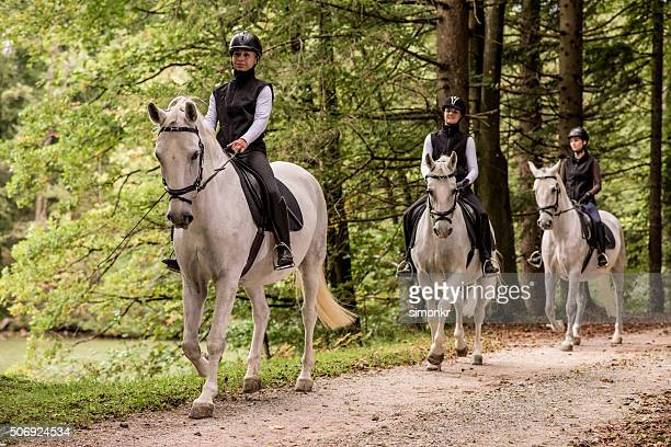 women riding horses - riding boot stock pictures, royalty-free photos & images