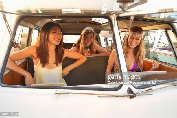 women riding in van - japanese girls hot stock photos and pictures