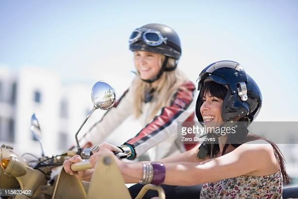 Women riding on a motorbike