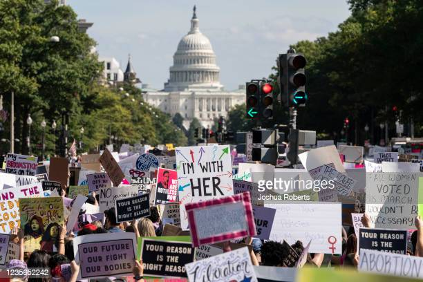 Women rights activists march to the U.S. Capitol during the annual Womens March October 2, 2021 in Washington, DC. The Women's March and other groups...