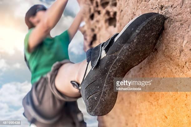 Women Rockclimber on A DIme Edge
