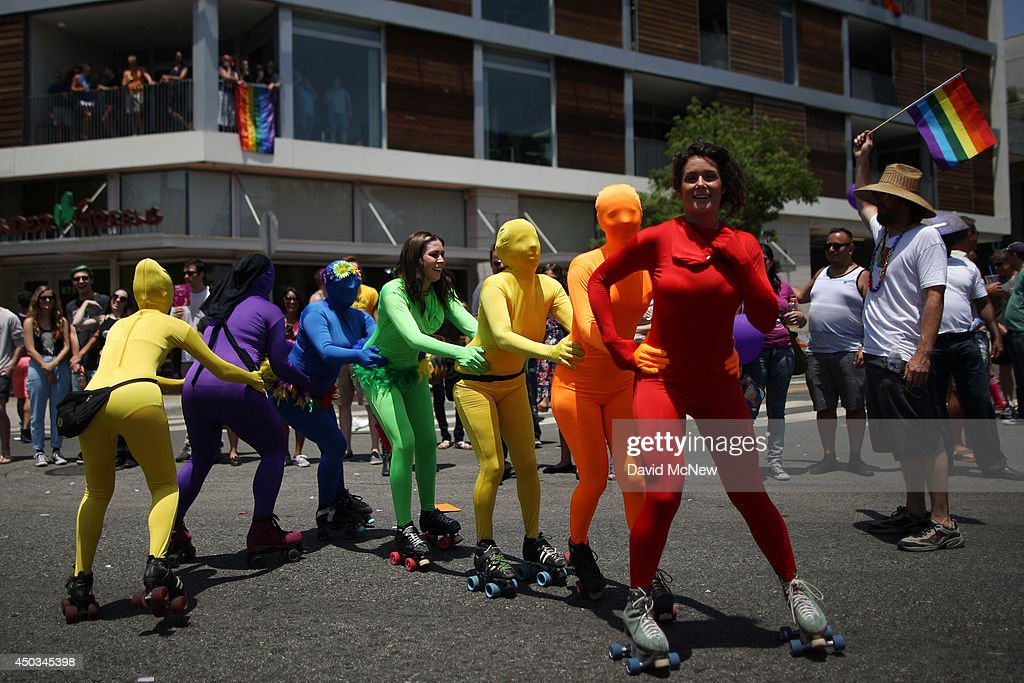 Women roller skate in rainbow-colored body suits in the LA Pride Parade on June 8, 2014 in West Hollywood, California. The LA Pride Parade and weekend events this year are emphasizing transgender rights and issues. The annual LGBT pride parade begin in 1970, a year after the Stonewall riots, and historically attracts more than 400,000 spectators and participants.