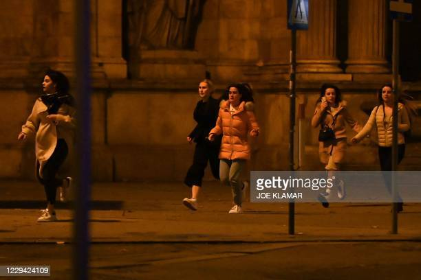 Women run away from the first district near the state opera, central Vienna on November 2 following a shooting near a synagogue. - Austrian Interior...