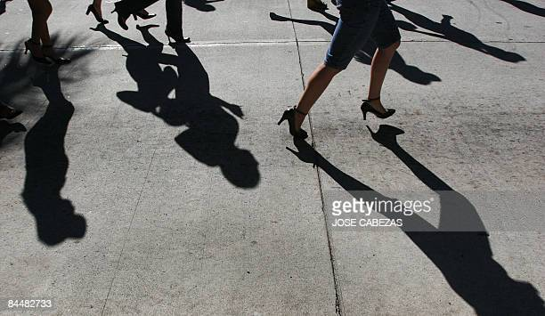 Women run during the 1st high heels race in San Salvador El Salvador on January 25 2009 The more than 800 women participating in the beneficiency...