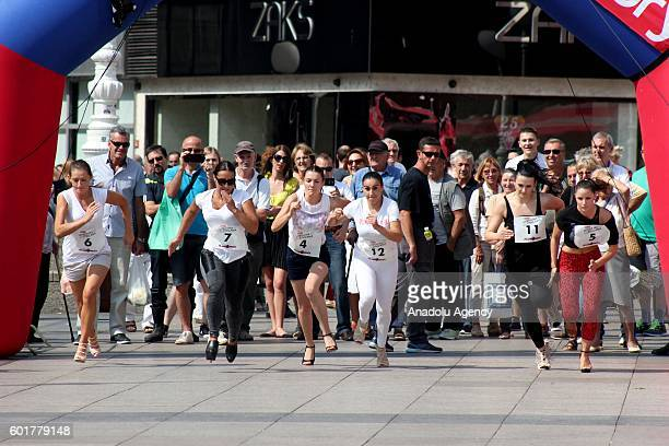 Women run on high heels during a competition organized by a magazine at Ban Jelacic Square in Zagreb Croatia on September 10 2016
