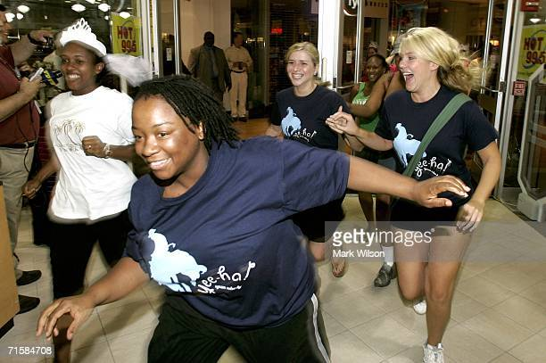 Women run thru the doors during Filene's Basement's annual sale August 4 2006 in Washington DC The annual sale dubbed the Running of the Brides is...