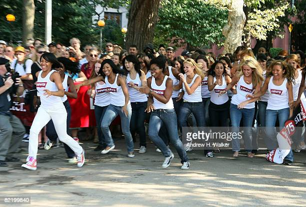 Women run to grab a pair of jeans at the Levi's Size Does Matter game on August 6 2008 in New York City