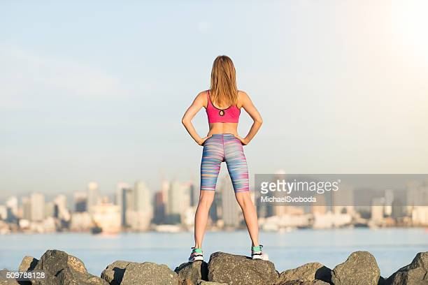 women runner stopping and looking at the city - women wearing spandex stock photos and pictures