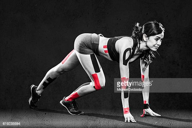 Women Runner With Kinesiology Tape On Her Joints