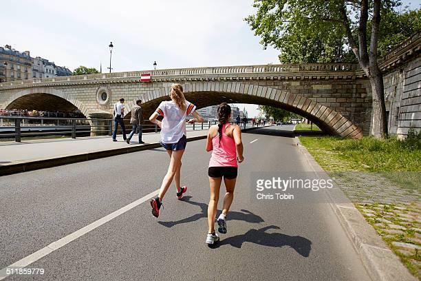 Women running along the Seine in Paris
