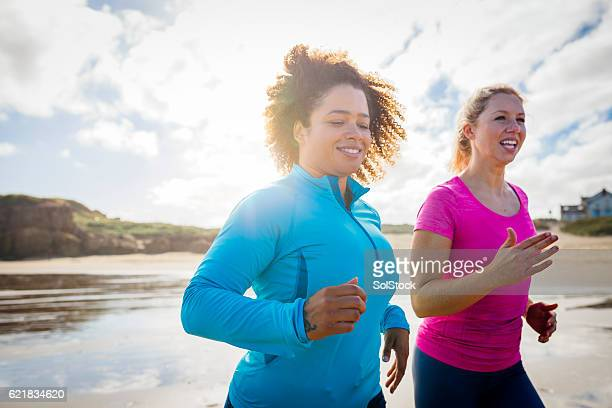 Women Running along the Shoreline