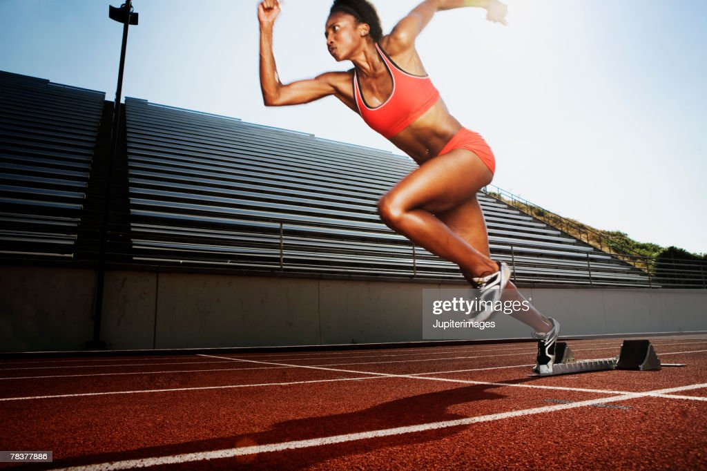 Women running on athletic track : Stock Photo