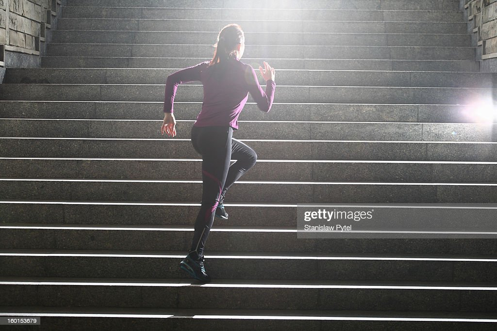 Women running on stairs : Stock Photo
