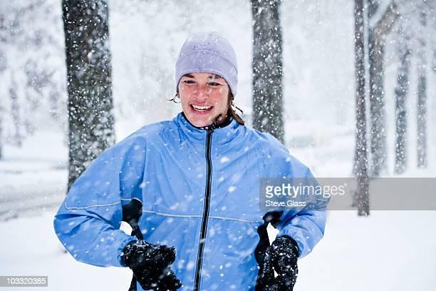 A women runs down Mountain Avenue in a snowstorm.