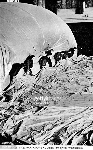 Women 's Auxiliary Air Force Balloon fabric workers Group of women standing with a partially inflated hot air balloon
