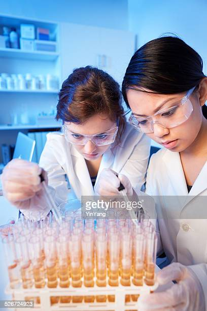 Women Scientist Students Working with University Chemistry Laboratory Test Tubes
