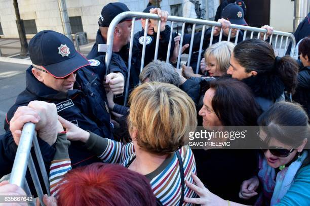 Women scuffle with police during a protest on February 16 2017 in Podgorica over social benefits cuts affecting mothers with three or more children...