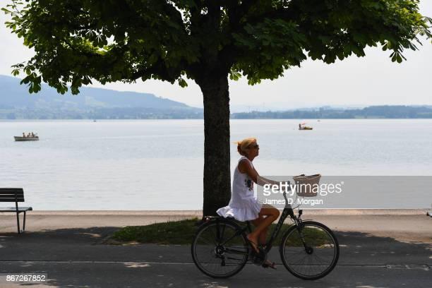 Women seen cycling along Lake Zug in Zug in June 21 2017 in Zug Switzerland