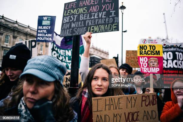 Women seen holding placards and posters during the march Scores of women across the United Kingdom took to the streets on Sunday to protest sexual...