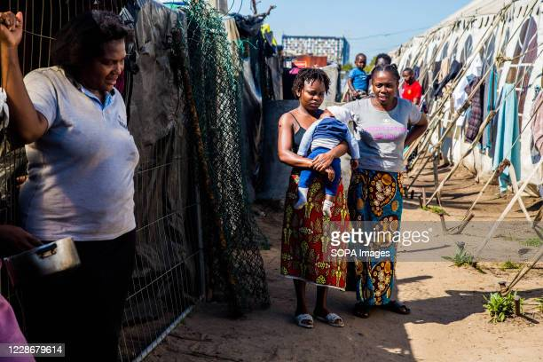 Women seen inside a refugee camp after being relocated. Due to xenophobic violence, many foreign nationals have been relocated to camps in Kensington...