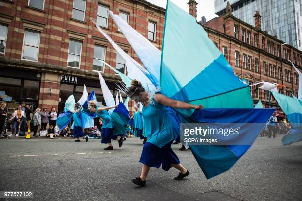 Women seen performing in colorful costumes during the Manchester day festival Manchester Day is an annual event that celebrates everything great...