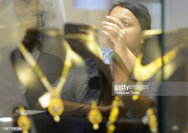 Women seen purchasing gold ornaments on the occasion of Dhanteras a Hindu festival associated with Lakshmi the Goddess of wealth at Sector 18 market...