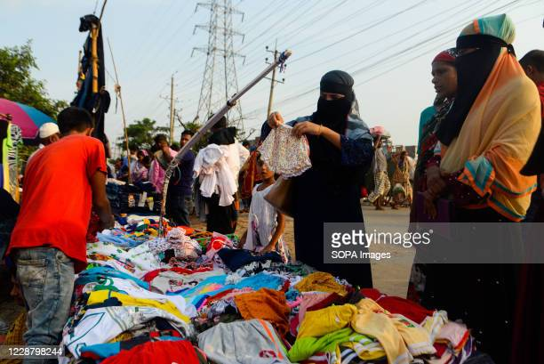 Women seen shopping for clothes on a street in Dhaka.