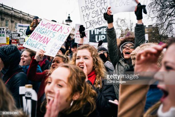 Women seen shouting slogans while holding placards and posters during the march Scores of women across the United Kingdom took to the streets on...