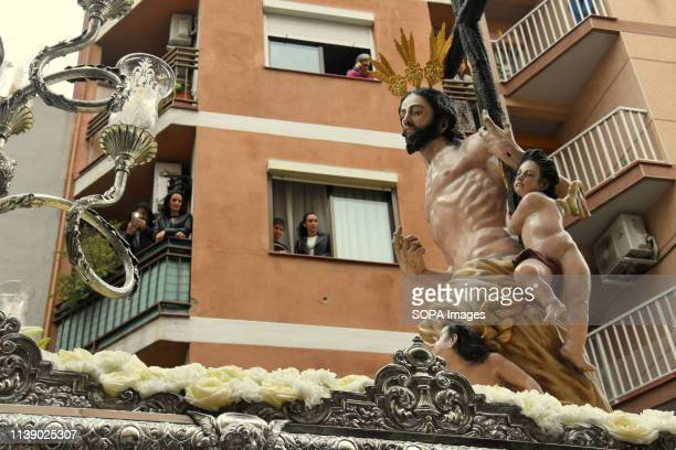 L´HOSPITALET CATALONIA SPAIN Women seen watching from windows of their house the image of Resurrected Christ during the parade Easter Parade 2019...