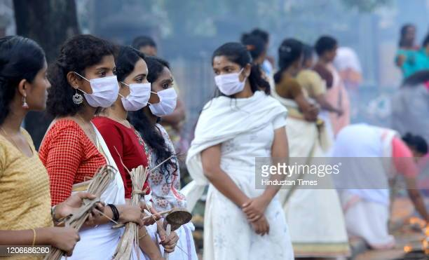 Women seen wearing facemasks amid rising Coronavirus scare during Attukal Pongala on March 9 2020 in Thiruvananthapuram India Lakhs of women lined up...