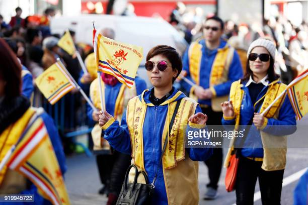 Women seen wearing traditional Chinese clothes during the chinese new year parade Thousand of participants take part in the Chinese New Year parade...