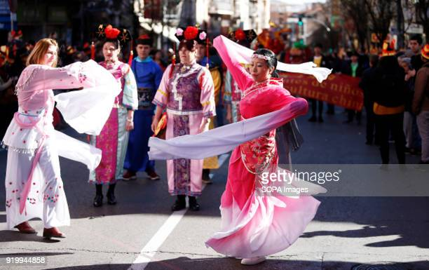 Women seen wearing traditional Chinese clothes while dancing during the chinese new year parade Thousand of participants take part in the Chinese New...