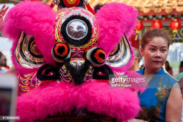 A women seen with the lion head during the lion dance performance at the Thean Hou Temple on the first day of Chinese New Year Chinese New Year is...