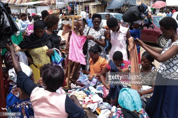 Women select clothing at a market in downtown Bujumbra Burundi on April 9 as daily life continues despite 3 positive cases of COVID19 coronavirus In...