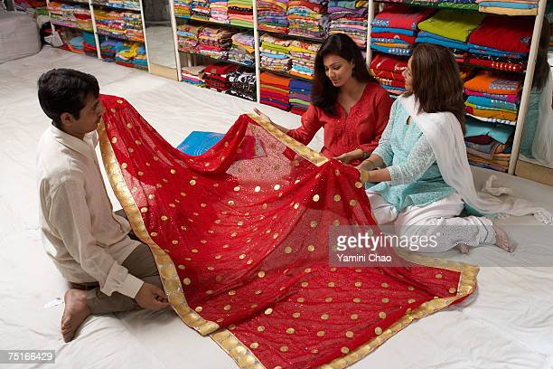 Women selecting sari in sari shop