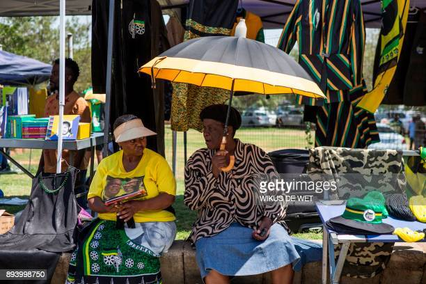 TOPSHOT Women sell merchandise on December 17 2017 in Johannesburg outside of the 54th ANC national conference South Africa's ruling African National...