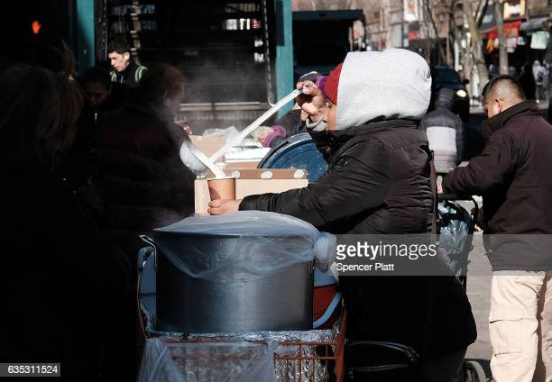 Women sell tamales and other Latin American cuisine on a street in the Jackson Heights neighborhood with a large Latino immigrant population on...
