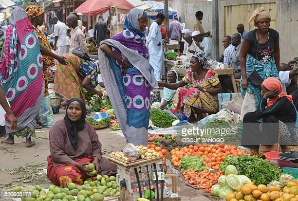 Women sell vegetables at a market in N'djamena on April 12 2016 / AFP / ISSOUF SANOGO