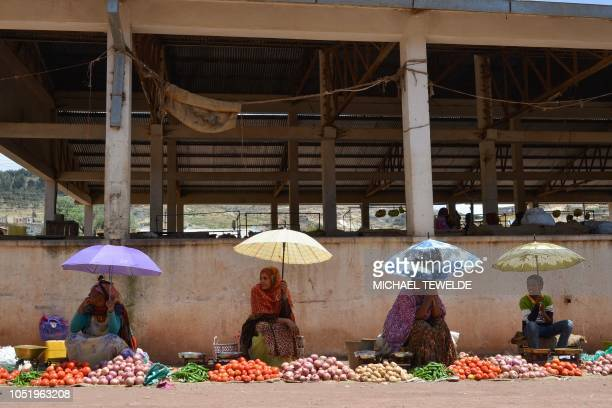 Women sell vegetables at a market in the southern Eritrean town of Senafe some 30km north of the border with Ethiopia on October 3 2018 The whirlwind...