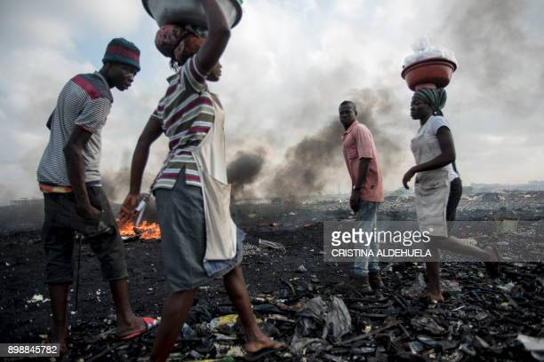 TOPSHOT Women sell water sachets at Agbogbloshie dumpsite in Accra on November 29 2017 The dumpsite is located in Agbogbloshie slum a former wetland...